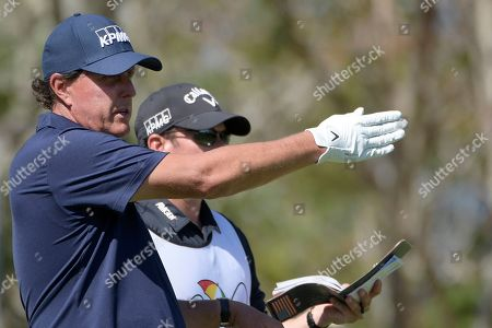 Phil Mickelson lines up a tee shot on the third hole during the second round of the Arnold Palmer Invitational golf tournament at Bay Hill, in Orlando, Fla