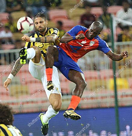 Al-Ittihad player Manuel Marouan Da Costa (L) in action for the ball with Al-Fayha player Sami Al-Khaibri (R) during the Saudi Arabia Professional League soccer match between  Al-Ittihad and Al-Fayha at King Abdullah International Stadium AlJawhra, Jeddah, Saudi Arabia, 8 March 2019.