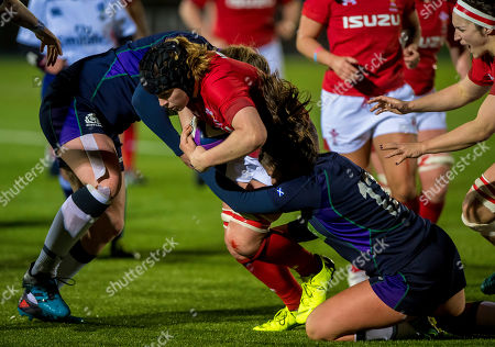 Scotland Women vs Wales Women. Scotland's Lisa Thomson tackles Bethan Lewis of Wales