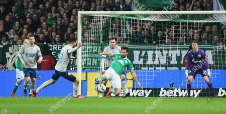 Bremen's Claudio Pizarro in action against Schalke's Nail Bentaleb (L)  and Steven Skrzybski (C) during the German Bundesliga soccer match between SV Werder Bremen and FC Schalke 04 in Bremen, Germany, 08 March 2019.