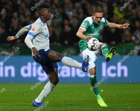 Bremen's Ludwig Augustinsson (R) in action with Schalke's Breel Embolo (L) during the German Bundesliga soccer match between SV Werder Bremen and FC Schalke 04 in Bremen, Germany, 08 March 2019.