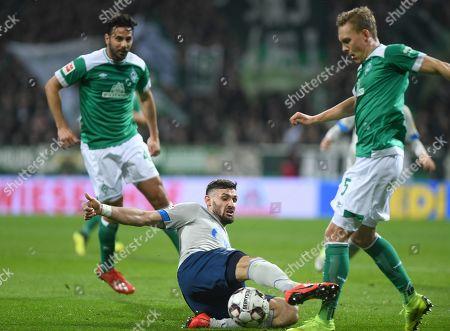 Bremen's Ludwig Augustinsson (R) in action against Schalke's Daniel Caligiuri (C) during the German Bundesliga soccer match between SV Werder Bremen and FC Schalke 04 in Bremen, Germany, 08 March 2019.