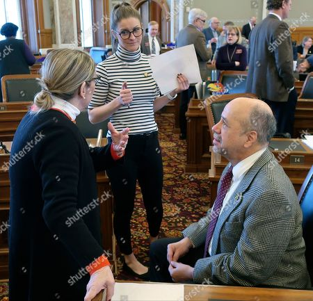 Kansas House Minority leader Tom Sawyer, right, D-Wichita, confers with his chief of staff, Heather Scanlon, center, and Rep. Annie Kuether, left, D-Topeka, following a vote on a Republican tax relief bill, at the Statehouse in Topeka, Kan. Democrats oppose the bill and argue it returns the state to failed tax-cutting policies under former Republican Gov. Sam Brownback