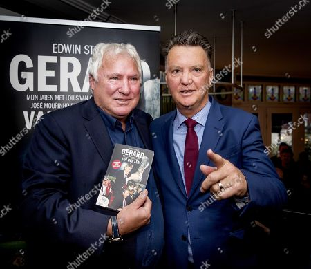 Dutch soccer coach Louis van Gaal (R) poses with former football trainer Gerard van der Lem during the presentation of his biography in Amsterdam, Netherlands, 08 March 2019.