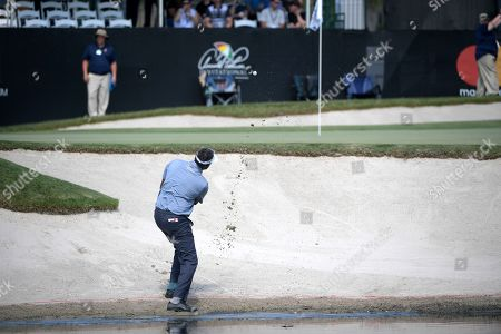 American track and field sprinter Noah Lyles trains at the National Training Center in Clermont, Florida. Vijay Singh, of Fiji Islands, hits out of a bunker onto the 17th green during the second round of the Arnold Palmer Invitational golf tournament, in Orlando, Fla