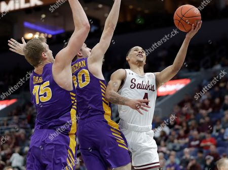 Stock Image of Southern Illinois' Eric McGill (4) heads to the basket past Northern Iowa's Justin Dahl and Spencer Haldeman (30) during the first half of an NCAA college basketball game in the quarterfinals of the Missouri Valley Conference men's tournament, in St. Louis