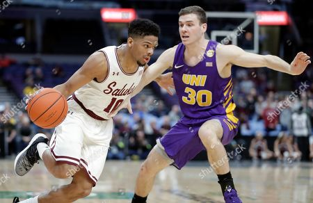 Southern Illinois' Aaron Cook, left, heads to the basket past Northern Iowa's Spencer Haldeman during the first half of an NCAA college basketball game in the quarterfinals of the Missouri Valley Conference men's tournament, in St. Louis