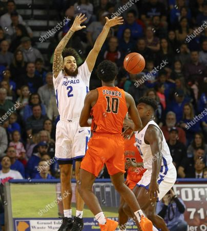 Stock Photo of Buffalo Bulls guard Jeremy Harris (2) defends against Bowling Green Falcons guard Justin Turner (10) during the first half of play in the NCAA Basketball game between the Bowling Green Falcons and Buffalo Bulls at Alumni Arena in Amherst, N.Y. (Nicholas T