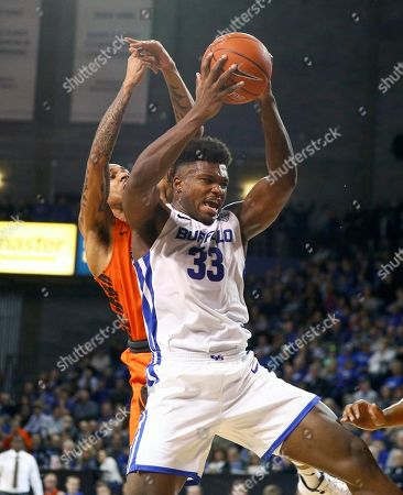 Buffalo Bulls forward Nick Perkins (33) grabs one of his six rebounds during the second half of play in the NCAA Basketball game between the Bowling Green Falcons and Buffalo Bulls at Alumni Arena in Amherst, N.Y. (Nicholas T