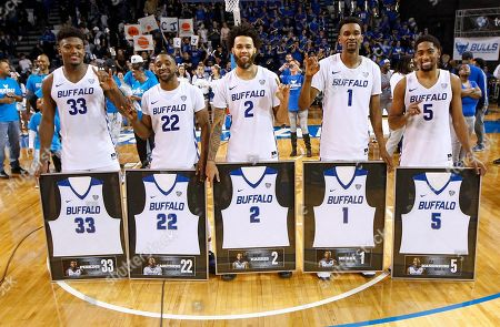 Buffalo Bulls seniors Nick Perkins (33), Dontay Caruthers (22), Jeremy Harris (2), Montell McRae (1), andCJ Massinburg (5) during a ceremony to honor the five seniors following their 84-73 win over Bowling Green Falcons in the NCAA Basketball game at Alumni Arena in Amherst, N.Y. The Bulls set new records for wins in a season with 28 and MAC Conference wins with 16. (Nicholas T