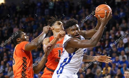 Stock Image of Buffalo Bulls forward Nick Perkins (33) grabs a rebound during the second half of play in the NCAA Basketball game between the Bowling Green Falcons and Buffalo Bulls at Alumni Arena in Amherst, N.Y. (Nicholas T