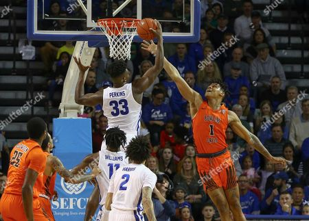 Stock Picture of Bowling Green Falcons forward Demajeo Wiggins (1) battles with Buffalo Bulls forward Nick Perkins (33) for a rebound during the first half of play in the NCAA Basketball game between the Bowling Green Falcons and Buffalo Bulls at Alumni Arena in Amherst, N.Y. (Nicholas T