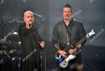 David Draiman, Dan Donegan. David Draiman, left, and Dan Donegan of the band Disturbed perform at the Allstate Arena, in Rosemont, Ill