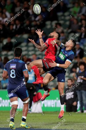 Jamie Henry (C) of the Sunwolves in action against Sonny Bill Williams (R) of the Blues during the Super Rugby match between Blues and Sunwolves in at the North Harbour Stadium in Auckland, New Zealand, 09 March 2019.