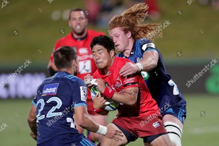 Rikiya Matsuda (C) of the Sunwolves is tackled by Otere Black (L) and Tom Robinson (R) of the Blues during the Super Rugby match between Blues and Sunwolves in at the North Harbour Stadium in Auckland, New Zealand, 09 March 2019.