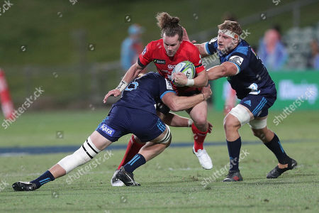 Michael Little (C) of the Sunwolves is tackled by Tom Robinson (L) and Blake Gibson (R) of the Blues during the Super Rugby match between Blues and Sunwolves in at the North Harbour Stadium in Auckland, New Zealand, 09 March 2019.