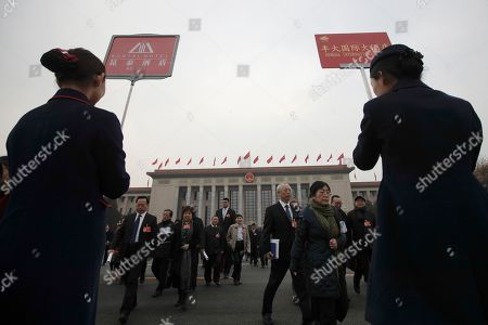 Former NBA basketball player Yao Ming, center left, a delegate to the Chinese People's Political Consultative Conference (CPPCC), leaves the Great Hall of the People with other delegates after attending a plenary session of the Chinese People's Political Consultative Conference (CPPCC) at the Great Hall of the People in Beijing
