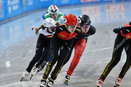 Kexin Fan of China, left, competes in ladies' 1500m semifinals, next to Canada's Courtney Lee Sarault, right, at the ISU World Short Track Speed Skating Championships in Sofia, Bulgaria, on