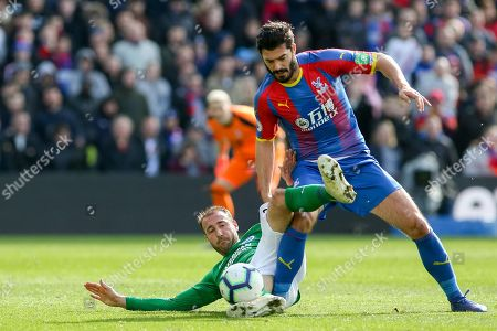 Brighton and Hove Albion striker Glenn Murray (17) tackles Crystal Palace #5 James Tomkins during the Premier League match between Crystal Palace and Brighton and Hove Albion at Selhurst Park, London