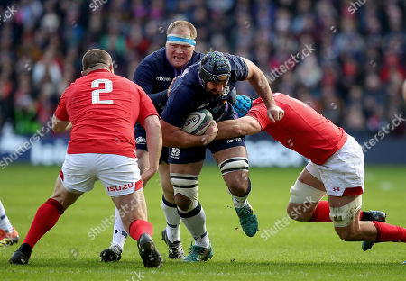 Scotland vs Wales. Scotland's Josh Strauss with Ken Owens and Justin Tipuric of Wales