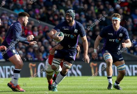 Scotland vs Wales. Scotland's Josh Strauss is tackled by Josh Navidi of Wales
