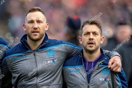 Byron McGuigan (#23)(left) and Greg Laidlaw (#21) of Scotland before the Guinness Six Nations match between Scotland and Wales at BT Murrayfield Stadium, Edinburgh