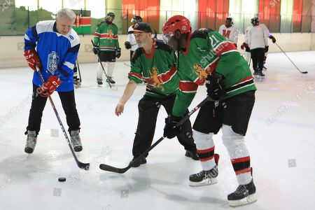 Stock Photo of The legendary Russian, international ice hockey player and United Nations Environment Patron for Polar regions, Slava Fetisov (L), in action during an ice hockey match against Kenya's 'Ice Lions' ice hockey team and the last team game ahead of the 4th UN Environment Assembly (UNEA), in Nairobi, Kenya, 09 March 2019. The match was among events that UN Environment had planned before the last ice hockey game that they are planning to be played in the Arctic in April 2020, that is meant to draw global attention and support to the rapid climate change in the polar regions that affects large parts of the planet, leading to rising global sea levels, floods and droughts.