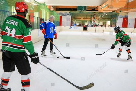 Stock Picture of The legendary Russian, international ice hockey player and United Nations Environment Patron for Polar Regions Slava Fetisov (2-L), in action during an ice hockey match against Kenya's 'Ice Lions' ice hockey team and the last team game ahead of the 4th UN Environment Assembly (UNEA), in Nairobi, Kenya, 09 March 2019. The match was among events that UN Environment had planned before the last ice hockey game that they are planning to be played in the Arctic in April 2020, that is meant to draw global attention and support to the rapid climate change in the polar regions that affects large parts of the planet, leading to rising global sea levels, floods and droughts.