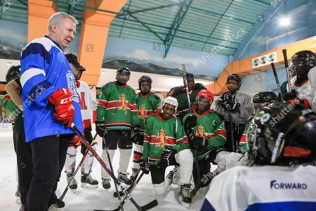 Stock Picture of The legendary Russian, international ice hockey player and United Nations Environment Patron for Polar Regions Slava Fetisov (L) talks to Kenya's 'Ice Lions' ice hockey team after a match against them and the last team game ahead of the 4th UN Environment Assembly (UNEA), in Nairobi, Kenya, 09 March 2019. The match was among events that UN Environment had planned before the last ice hockey game that they are planning to be played in the Arctic in April 2020, that is meant to draw global attention and support to the rapid climate change in the polar regions that affects large parts of the planet, leading to rising global sea levels, floods and droughts.