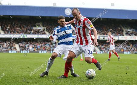 Charlie Adam of Stoke City battles with  Nahki Wells of Queens Park Rangers