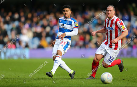 Massimo Luongo of Queens Park Rangers and  Charlie Adam of Stoke City
