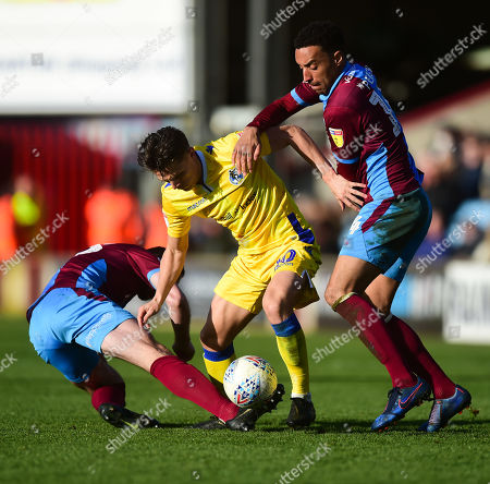 Tom Nichols of Bristol Rovers battles for the ball with James Perch of Scunthorpe United