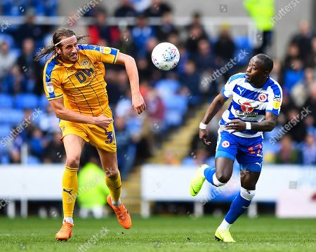 Jonas Olsson of Wigan Athletic left vies with Modou Barrow of Reading during Reading vs Wigan Athletic, Sky Bet EFL Championship Football at the Madejski Stadium on 9th March 2019