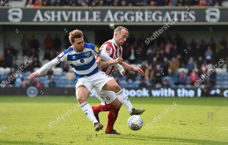Luke Freeman of Queens Park Rangers and Charlie Adam of Stoke City