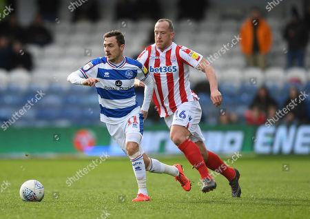 Josh Scowen of Queens Park Rangers and Charlie Adam of Stoke City