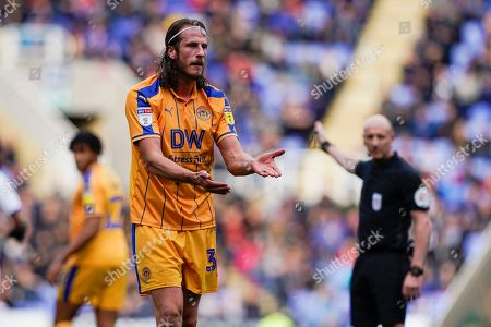 Jonas Olsson of Wigan Athletic appeals to the ref during the EFL Sky Bet Championship match between Reading and Wigan Athletic at the Madejski Stadium, Reading