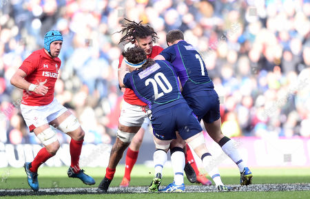 Josh Navidi of Wales is tackled by Hamish Watson and Jamie Ritchie of Scotland.