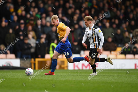Stock Image of Willem Tomlinson of Mansfield Town is chased by Tom Conlon of Port Vale.