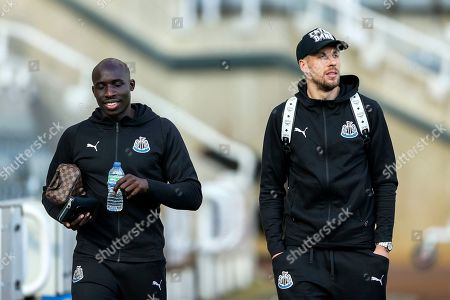Mohamed Diame (#10) of Newcastle United and Florian Lejeune (#20) of Newcastle United arrive ahead of the Premier League match between Newcastle United and Everton at St. James's Park, Newcastle