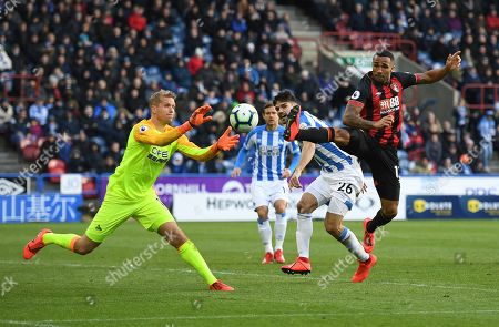 Callum Wilson of Bournemouth goes close but Jonas Lossl goalkeeper of Huddersfield Town claims the ball