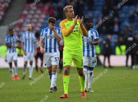 Jonas Lossl goalkeeper of Huddersfield Town applauds the fans at full time