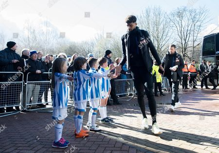 Philip Billing of Huddersfield Town meets children as he arrives for the game