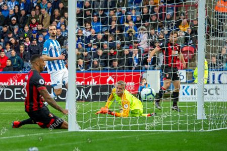 Goal Jonas Lossl of Huddersfield Town looks as the ball goes in as Callum Wilson of Bournemouth scores a goal 0-1 to take the lead during the Premier League match between Huddersfield Town and Bournemouth at the John Smiths Stadium, Huddersfield