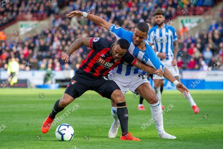 Callum Wilson of Bournemouth battles with Mathias Zanka Jorgensen of Huddersfield Town during the Premier League match between Huddersfield Town and Bournemouth at the John Smiths Stadium, Huddersfield