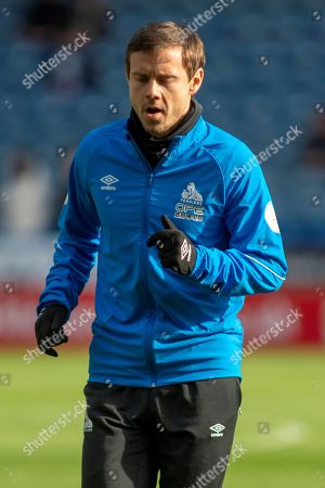 Chris Lowe of Huddersfield Town warms up for the Premier League match between Huddersfield Town and Bournemouth at the John Smiths Stadium, Huddersfield