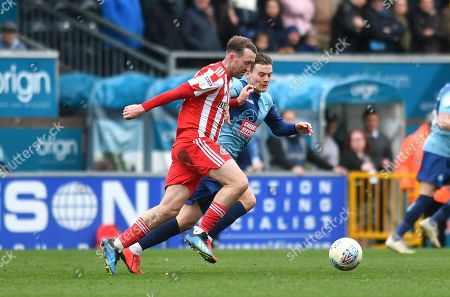 Wycombe Wanderers Dominic Gape(4) challenges Sunderland midfielder Aidan McGeady (19) *** during the EFL Sky Bet League 1 match between Wycombe Wanderers and Sunderland at Adams Park, High Wycombe