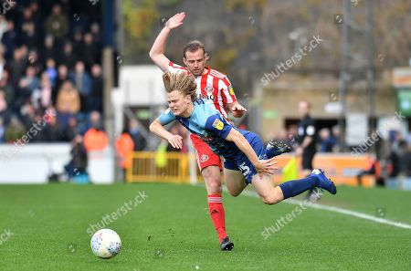 Wycombe Wanderers Alex Samuel (25) is fouled by Sunderland midfielder Lee Cattermole (6) *** during the EFL Sky Bet League 1 match between Wycombe Wanderers and Sunderland at Adams Park, High Wycombe