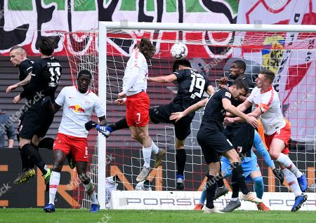 Augsburg's Ja-Cheol Koo, fifth from left, challenges for the ball against Leipzig's Marcel Sabitzer, fourth from left, during the German first division Bundesliga soccer match between RB Leipzig and FC Augsburg in Leipzig, Germany