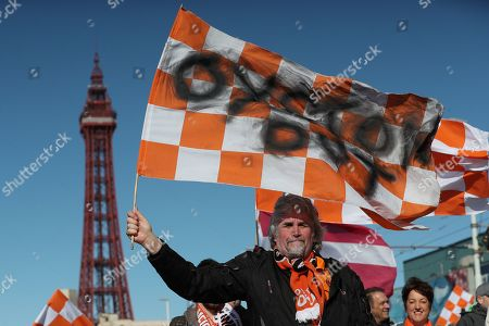 Blackpool fan David Boyd marches with other Blackpool fans from the tower to Bloomfield Road as they celebrate the first home game since the Oyston family were removed from control of the club