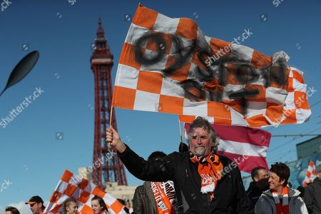 Stock Image of Blackpool fan David Boyd marches from the tower to Bloomfield Road along with other Blackpool fans in celebration of the Oyston family have been removed from power air Blackpool FC